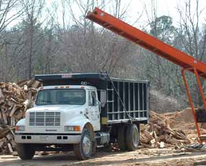 Loading Trucks with Firewood